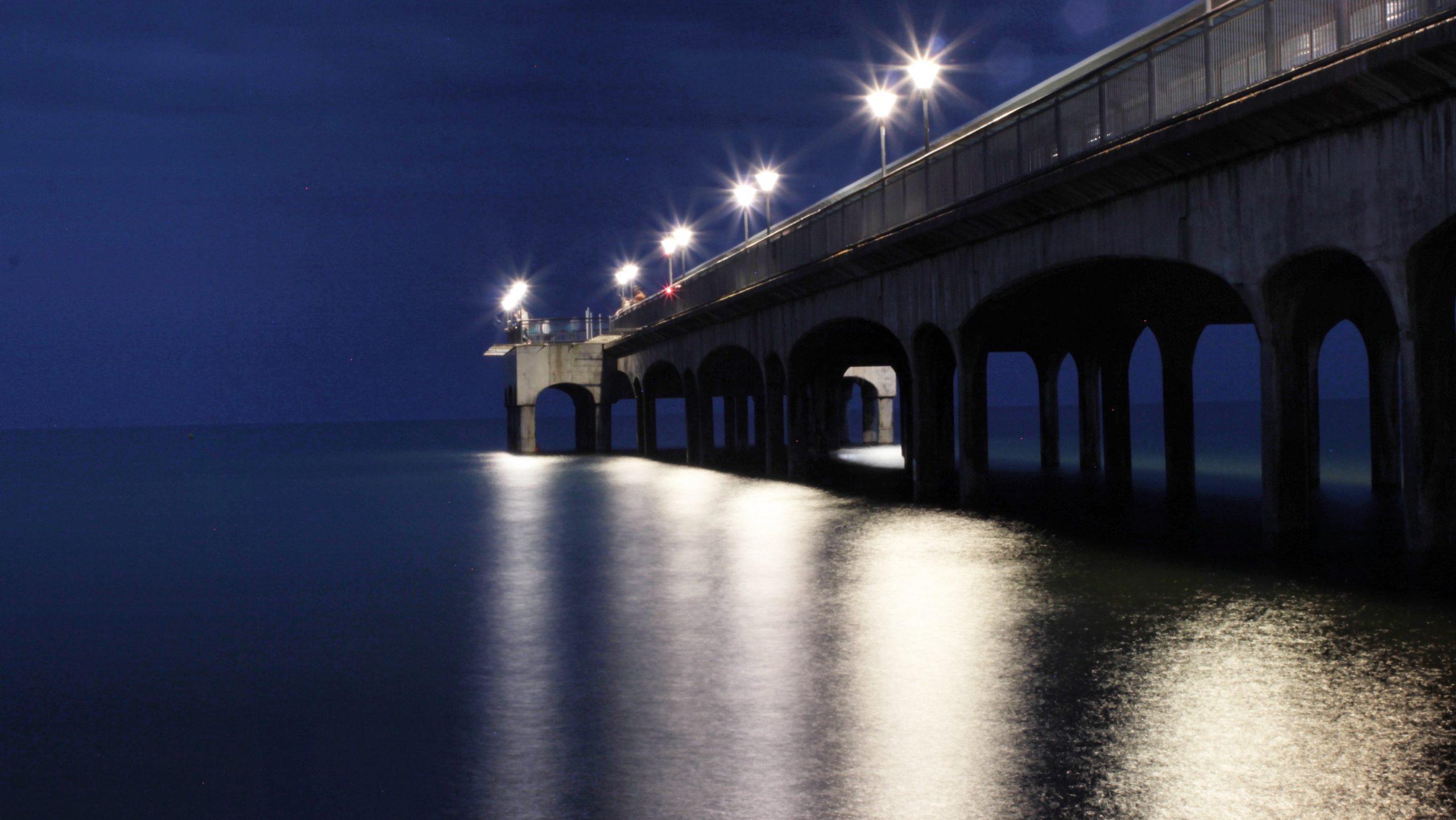 Boscombe pier night reflected lights